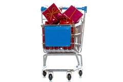 Einkaufswagen mit Geschenken Stockfotos
