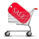 Einkaufswagen mit Verkaufsmarke. Konzept des Rabattes. Stockfotos