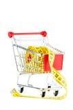 Einkaufswagen und Bandmaß stockfotos