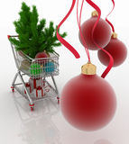 Einkaufswagen voll mit Weihnachtskugeln Tannenbaum und Geschenkboxen Stockbild