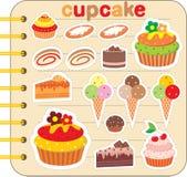 Einklebebuchelemente mit kleinen Kuchen. Stockfoto