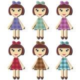 Einklebebuchmädchen in den verschiedenen Kleidern Stockbilder