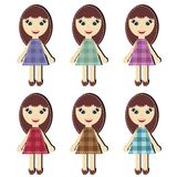 Einklebebuchmädchen in den verschiedenen Kleidern Stockfoto