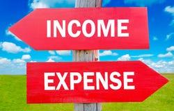 Einkommen und Ausgabe Stockfotos