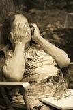 Einsame alte Frau Lizenzfreie Stockfotos