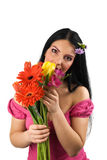 Einsame Frau mit Frühlingsblumen Stockfotos