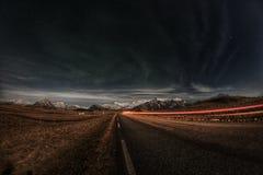 Einsame Straße in Hofn Stockfotos