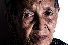 Einsames älteres Frauenporträt Stockfotografie