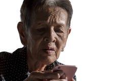 Einsames älteres Frauenporträt Stockfotos