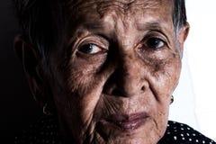 Einsames älteres Frauenporträt Lizenzfreie Stockfotografie