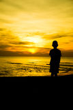 Einsames Junge Schattenbild Stockfoto