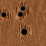Einschusslöcher im Holz Stockbild