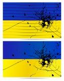 Einschussloch Ukrainerflaggen Lizenzfreie Stockfotos