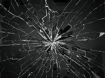 Einschussloch und Stücke zerbrochenes oder zertrümmertes Glas stock abbildung