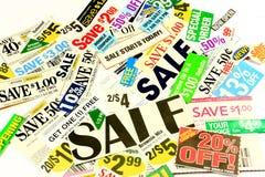 Einsparung-Geld mit Kupons und Special-Abkommen Stockbilder