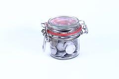 Einsparungs-Geld im Glas Stockbild