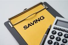 Einsparungs-Text für Finanzkonzept Stockbild