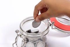 Einsparungsgeld im Glas Stockbild