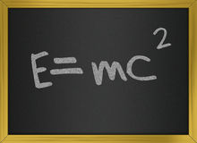 Einstein formula of relativity on blackboard Stock Images