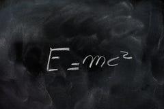 Einstein relativity formula e=mc2 on black chalk board Royalty Free Stock Photos