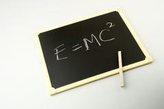 Einstein's famous equation. On a blackboard Stock Photos