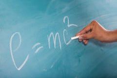 Einstein's Formula E=mc2 on a blackboard Stock Photos