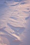 Einstellung Sun auf Schnee Stockbild