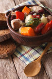 Eintopf with meat, sausages and vegetables close-up vertical Stock Image
