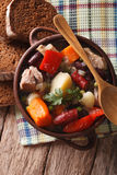 Eintopf with meat, sausages and vegetables closeup. vertical top Stock Photography