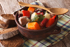 Eintopf rich soup with meat, sausages and vegetables close-up Royalty Free Stock Images