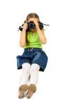 Eintragfäden des kleinen Mädchens mit dslr Kamera Stockfoto