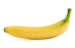 Einzelne gelbe fleckenlose Banane über Weiß lizenzfreie stockfotos