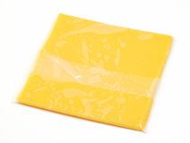 Einzelne Scheibe des amerikanischen Käses Stockbilder