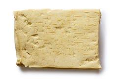 Einzelner Block des weißen Tofus lokalisiert auf Weiß Stockbilder