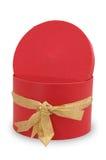 Einzelner roter Geschenkkasten mit goldenem Farbband Lizenzfreie Stockfotos