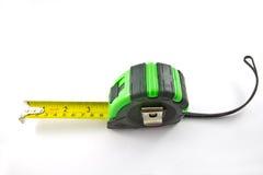 Einzelnes grünes und schwarzes Bandmaß stockfotos
