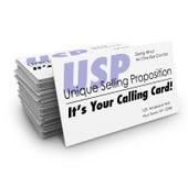 Einzigartiger Verkaufsvorschlag USPs Ihr nennender Visitenkarte-Stapel Lizenzfreie Stockfotografie