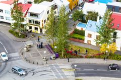 Eiriksgata street in Reykjavik city in autumn. REYKJAVIC, ICELAND - SEPTEMBER 4, 2017: above view people and cars on Eiriksgata street in Reykjavik city in Royalty Free Stock Photos