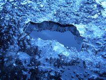 Eis-Loch Stockfoto