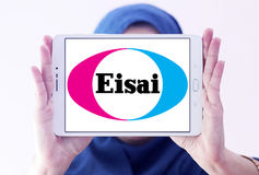 Eisai Pharmaceutical Company logo. Logo of Eisai Pharmaceutical Company on samsung tablet holded by arab muslim woman . Eisai is a Japanese pharmaceutical Stock Photos