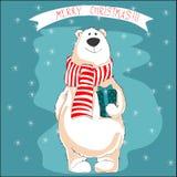 Eisbär im roten Schal Anhalten des Weihnachtsgeschenks Stockbilder