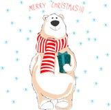 Eisbär im roten Schal Anhalten des Weihnachtsgeschenks Stockbild