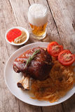 Eisbein: baked pork shank and braised cabbage and beer. vertical Stock Photos