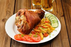 Eisbein with french fries, vegetables and beer Stock Images