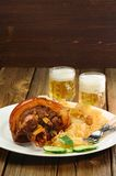 Eisbein with light beer on wooden background Royalty Free Stock Photo