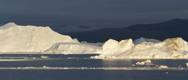 Eisberge im Sonnenuntergang Stockbilder