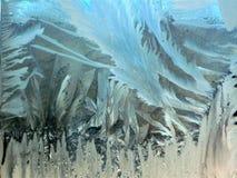 Eisblumen auf dem Winterfenster Lizenzfreie Stockfotos