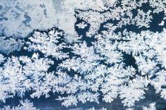 Eisblumen auf Glas Stockbild