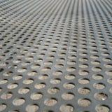 Eisen-Platte mit Löchern Stockbild