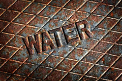 Eisen-Wasser-Gebrauchsabdeckung Stockfoto